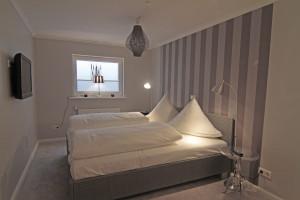 Schlafzimmer in der Ferienwohnung Strandläufer